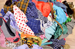 Close up on a big pile of clothes and accessories thrown on the Royalty Free Stock Images