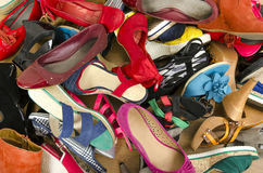 Close up on big pile of colorful woman shoes. Royalty Free Stock Photo