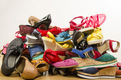 Close up on big pile of colorful woman shoes. Stock Image
