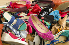 Close up on big pile of colorful woman shoes. Stock Photos