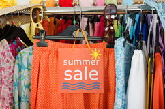 Close up on a big sale sign for summer clothes. Stock Photos