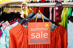 Rack With Summer Clothes And Sale Sign. Stock Photo - Image: 41821096