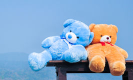 Close up big teddy bears  sitting on wood chair Stock Photo