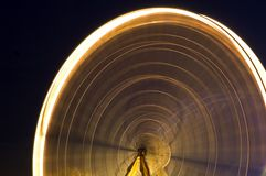 Close up of the big wheel in motion at a fair. Close up of the big wheel at a fair at night with long shutter Stock Image