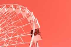 Close-up big white modern ferris wheel against clear sky on background in Kiev city center. One black gondola among other. One of royalty free stock photos
