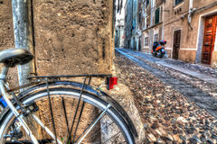 Close up of a bike wheel in Alghero old town Royalty Free Stock Photos