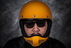 Close up of biker man in motorcycle helmet and leather jacket. Close up of biker man in motorcycle helmet and black leather jacket Stock Photos
