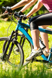 Close-up of bikers legs on bikes Stock Photography