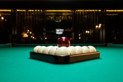 Close-up billiard balls ivory folded triangle on a table covered with green baize.  stock images