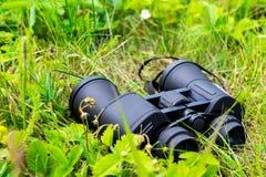 Close-up of binoculars on green grass Royalty Free Stock Photos