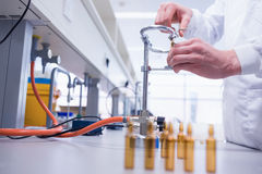 Close up of a biochemist sealing a vial. In laboratory Royalty Free Stock Images