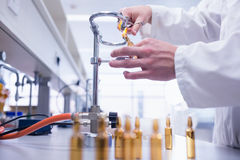 Close up of a biochemist sealing a vial. In laboratory Stock Photos
