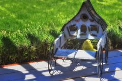 Close up of a bird house in a wagon on a deck stock images