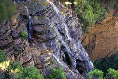 Close up bird view waterfall on rock cliff mountain stock image