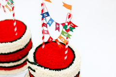 Close up of birthday cake with banner. Close up of two red birthday cakes with banner and red icing Royalty Free Stock Photo
