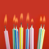 Close up of birthday candles. Studio shot close up of lite birthday candles royalty free stock photo