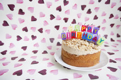 Close-up of birthday candles on cake over heart shaped background Royalty Free Stock Photo
