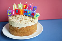 Close-up of birthday candles on torte cake over colored background Stock Photos