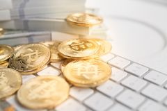 Bitcoin with little figure on keyboard Royalty Free Stock Photography