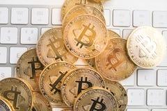 Bitcoin with little figure on keyboard Stock Photo