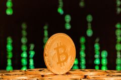 Close up of bitcoin with numbers in backgrounds Stock Image