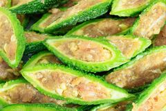 Close up bitter gourd pile with stuffed hack pork and garlic black pepper ingredient. vegetable herb Nourish the health body. Thai food stock image