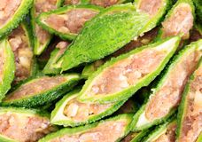 Close up bitter gourd pile with stuffed hack pork and garlic black pepper ingredient. vegetable herb Nourish the health body. Thai food stock photo