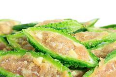 Close up bitter gourd pile with stuffed hack pork and garlic black pepper ingredient. vegetable herb Nourish the health body. Thai food royalty free stock photo