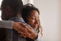 Free Close Up Black African Wife Embracing Husband Royalty Free Stock Photography - 128706217