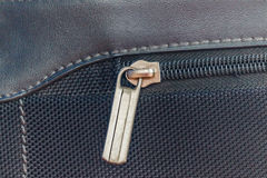 Close up of black  bag zipper, black  bag close up. Stock Photos