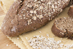 Close-up of black bread with wheat and decorated with wheat. On. Wooden borad stock image
