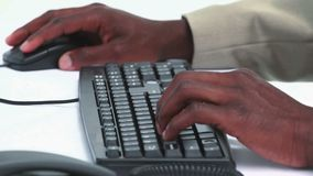 Close up on a black businessman hands. Typing on a keyboard stock footage