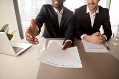 Close up of black businessman offering job, employment agreement Stock Photos