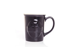 Close up black ceramic cup on white royalty free stock images