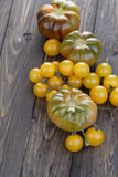 Close up of black an cherry tomatoes Royalty Free Stock Image