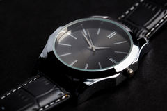 Close up of black classic male wristwatch Stock Images
