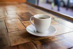 Close up of black coffee in cup on table Stock Photo