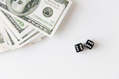 Close up of black dice and dollar money on table Royalty Free Stock Images