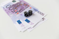 Close up of black dice and euro cash money Stock Images