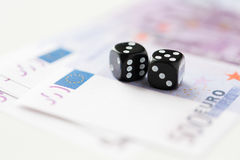 Close up of black dice and euro cash money Royalty Free Stock Image