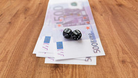 Close up of black dice and euro cash money Stock Photography