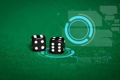Close up of black dice on green casino table Stock Photography
