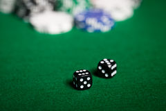 Close up of black dices on green casino table Royalty Free Stock Image