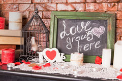 Close up of a black dirty board with the words Love grows here w Stock Photo