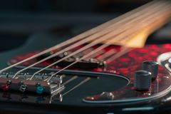 Close-up of a black electric bass royalty free stock images