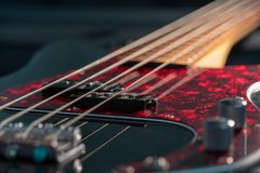 A Close-up of a black electric bass royalty free stock images