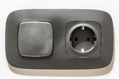 Close-up of black electric socket with light switch Stock Images