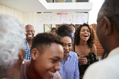 Close up of African American  family welcoming grandparents home for a surprise party stock photos