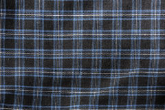 Close up of black-gray-blue checked fabric Royalty Free Stock Images