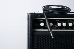Close up of Black guitar amplifier with jack cable. On white background Royalty Free Stock Photo